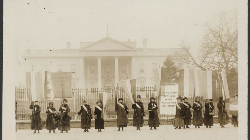 Photo provided by the Library of Congress howing Suffragists picketing in front of the White House i