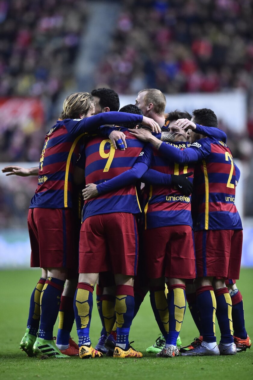 FC Barcelona's players celebrate a goal by Lionel Messi during their Spanish La Liga soccer match between Sporting de Gijon and FC Barcelona at El Molinon stadium, in Gijon, northern Spain, Wednesday, Feb.17, 2016. (AP Photo/Alvaro Barrientos)