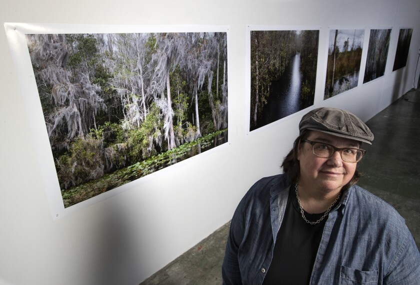 Catherine Opie before her images of swamps in her Lincoln Heights studio.