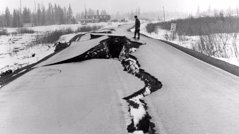 Fissures in a road after the 1964 earthquake in Alaska.