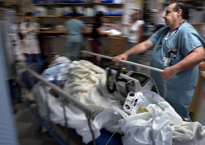 A trauma patient is rushed into the emergency room at Harbor-UCLA Medical Center.