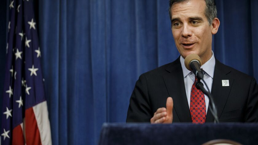 Los Angeles Mayor Eric Garcetti answer questions during a press conference in Los Angeles, Calif. on May 3.