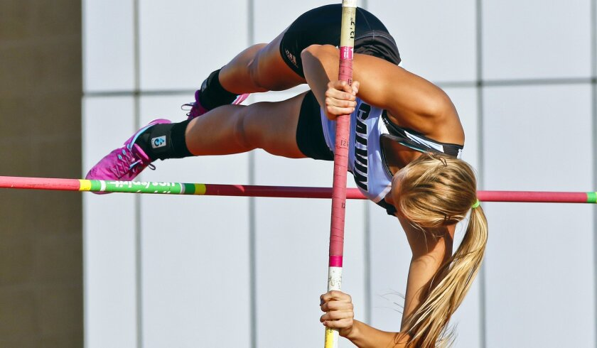 Calvin Christian senior Sara Wagenveld clears 11-7 in the pole vault Friday night in the Escondido Invitational.