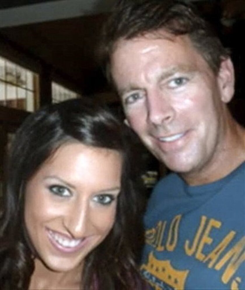 This undated photo provided by a family friend shows former Anheuser-Busch CEO August Busch IV, right, and his girlfriend Adrienne Martin. August Busch IV enjoyed a seemingly charmed life with good looks, money and a bevy of beautiful women. But his playboy lifestyle landed him in legal trouble, and he took the throne at the king of beers, only to see the company sold out from under him. Now, the scion of St. Louis' richest and most powerful family is back in the national headlines after his 27-year-old girlfriend was found dead at his home on Dec. 19, 2010 of unknown causes. (AP Photo/Family photo via St. Louis Post-Dispatch) EDWARDSVILLE INTELLIGENCER OUT; THE ALTON TELEGRAPH OUT; NO SALES