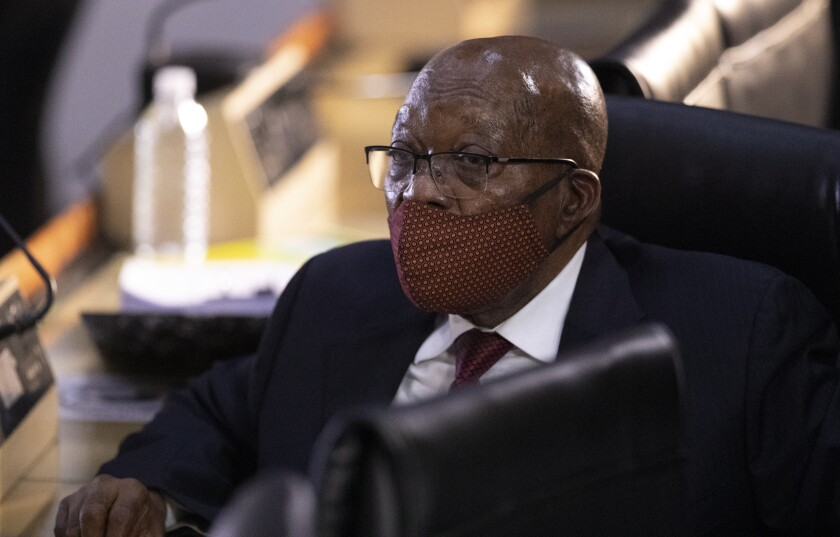 Former South African President Jacob Zuma appears at the hearing for his application for Deputy Chief Justice Raymond Zondo, to recuse himself from the state capture commission inquiry in Johannesburg, South Africa, Monday, Nov. 16, 2020. (AP Photo/Themba Hadebe)