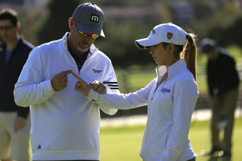 December 13th 2014 Mission Valley, CA- Certified Aimpoint instructor for Southern California Bob Townsend, left, gives Cecelia DeMatteo, a junior at Rancho Bernardo High School, instructions on how to aim her putt by using her fingers during an Aimpoint putting lesson at Riverwalk Golf Club. Photo