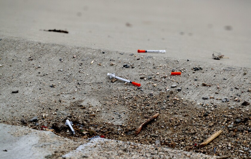 Syringes dot the banks of the Santa Ana River in 2017.