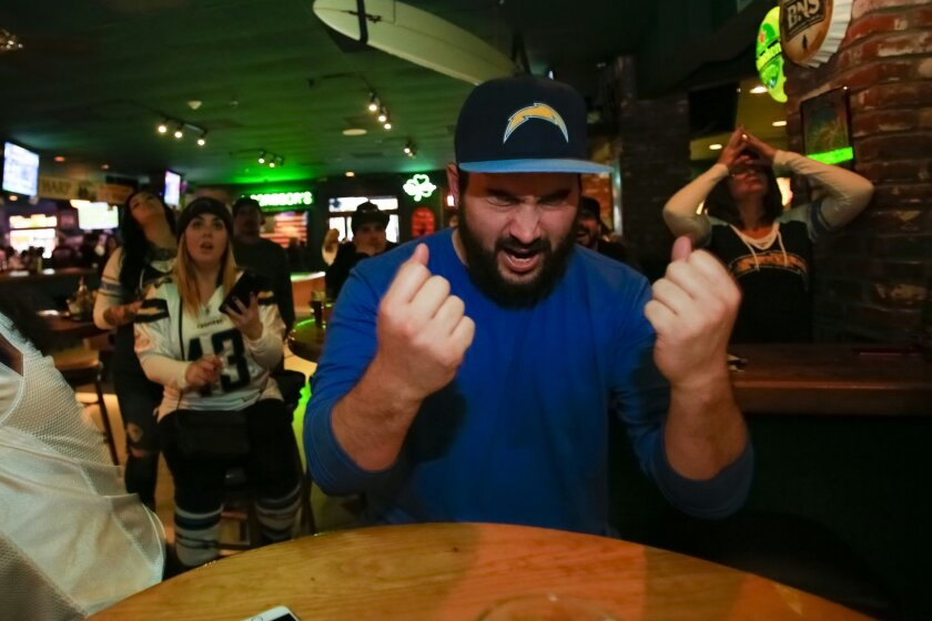 SAN DIEGO, CA, JANUARY 3, 2016: ..Andrew Metzgus reacts after the Denver Broncos scoring a touchdown in the 4th quarter against the San Diego Chargers.  Metzgus was just one of the many that packed the local bar McGregors not from Qualcomm Stadium to watch the Chargers play their last football game