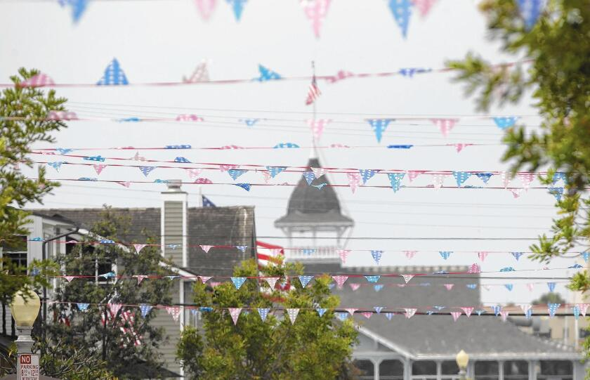 Fourth of July banners are strung house to house across Topaz Street on Balboa Island.