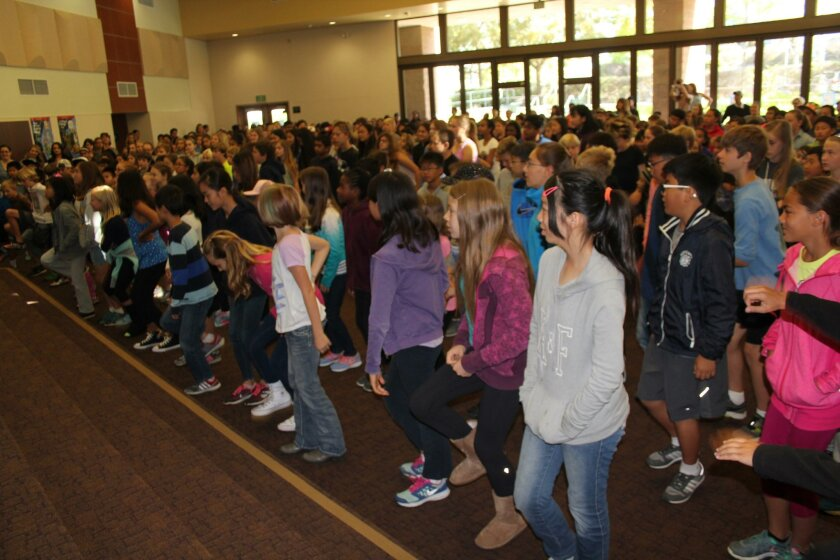 Solana Pacific students SLAM ALS by stomping their feet at a May 2 assembly.
