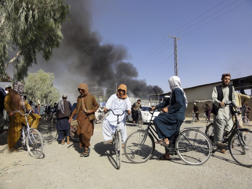 Smoke rises after fighting between the Taliban and Afghan security personnel, in Kandahar, southwest of Kabul, Afghanistan, Thursday, Aug. 12, 2021. (AP Photo/Sidiqullah Khan)