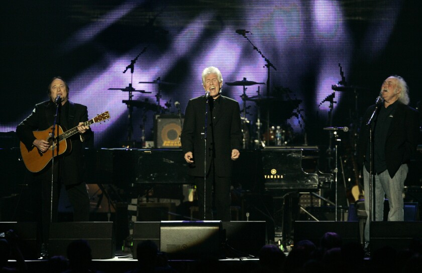 Stephen Stills, left, Graham Nash and David Crosby, shown during a 2010 concert tribute to Neil Young, will headline the 2nd Light up the Blues concert on Saturday in Los Angeles benefiting Autism Speaks.