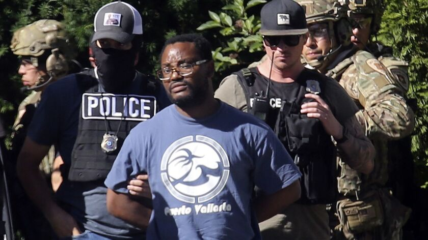 Salt Lake City police take Ayoola Ajayi into custody Friday. Ajayi was arrested on suspicion of aggravated murder, kidnapping and desecration of a body in the death of 23-year-old Mackenzie Lueck.