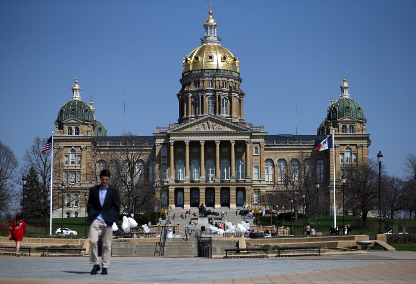 The Iowa state Capitol in Des Moines. Hillary Rodham Clinton is traveling in a van on a road trip to her first official campaign events in Iowa on Tuesday.