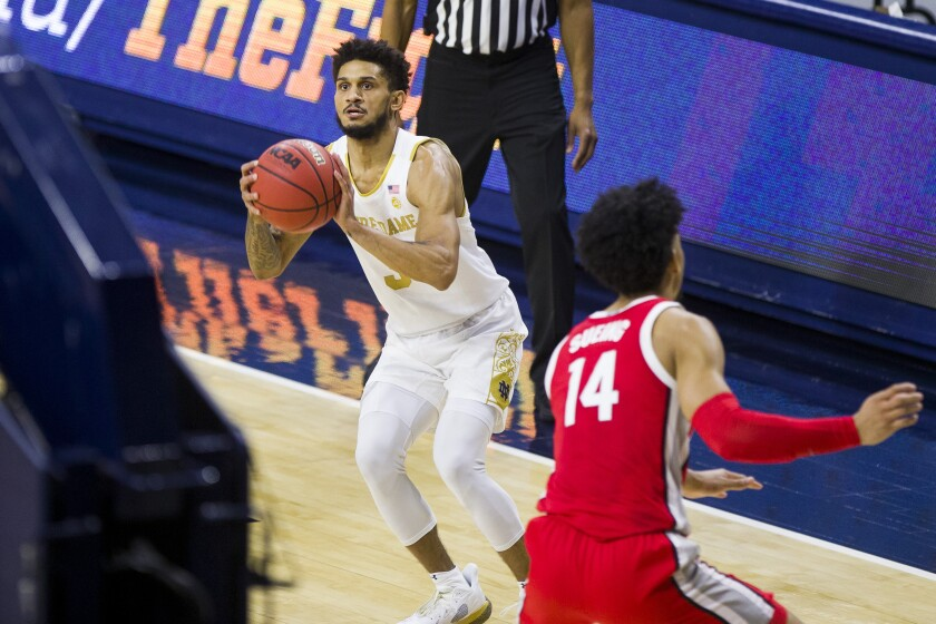 Notre Dame's Prentiss Hubb (3) sets up for a 3-pointer near Ohio State's Justice Sueing (14) during the second half of an NCAA college basketball game Tuesday, Dec. 8, 2020, in South Bend, Ind. Ohio State won 90-85. (AP Photo/Robert Franklin)