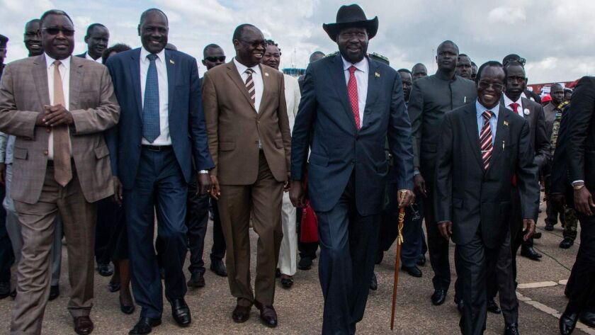 South Sudan's President Salva Kiir, second from left, arrives in Juba, the capital, on Friday. Kiir returned from Ethiopia's capital after a face-to-face meeting with opposition leader Riek Machar for the first time in almost two years.