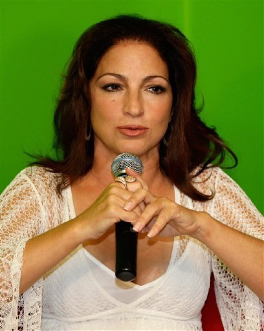"Latin singer Gloria Estefan answers a question during a news conference after her arrival in San Juan, Tuesday, Oct. 6, 2009. Estefan will perform her show ""Where Everything Began"" on Saturday. (AP Photo/Andres Leighton)"