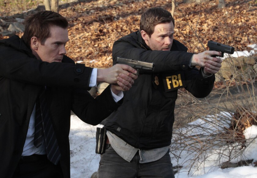 """Fox, coming off a dismal ratings season, has completed its upfront ad sales with $1.8 billion in commitments. Above, one of Fox's most promising shows, """"The Following,"""" starring Kevin Bacon, left, and Shawn Ashmore, will return for a second season."""
