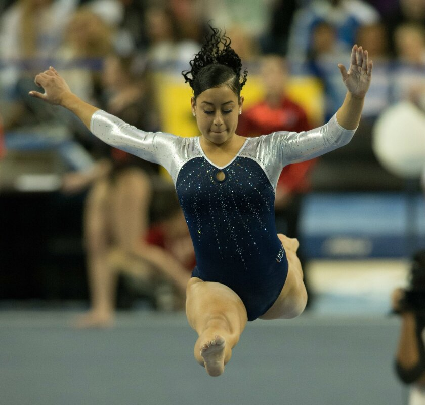 UCLA gymnast Sophina DeJesus, a Temecula Valley graduate, competes on the beam during UCLA's Pac 12 meet against Utah on Jan. 12.
