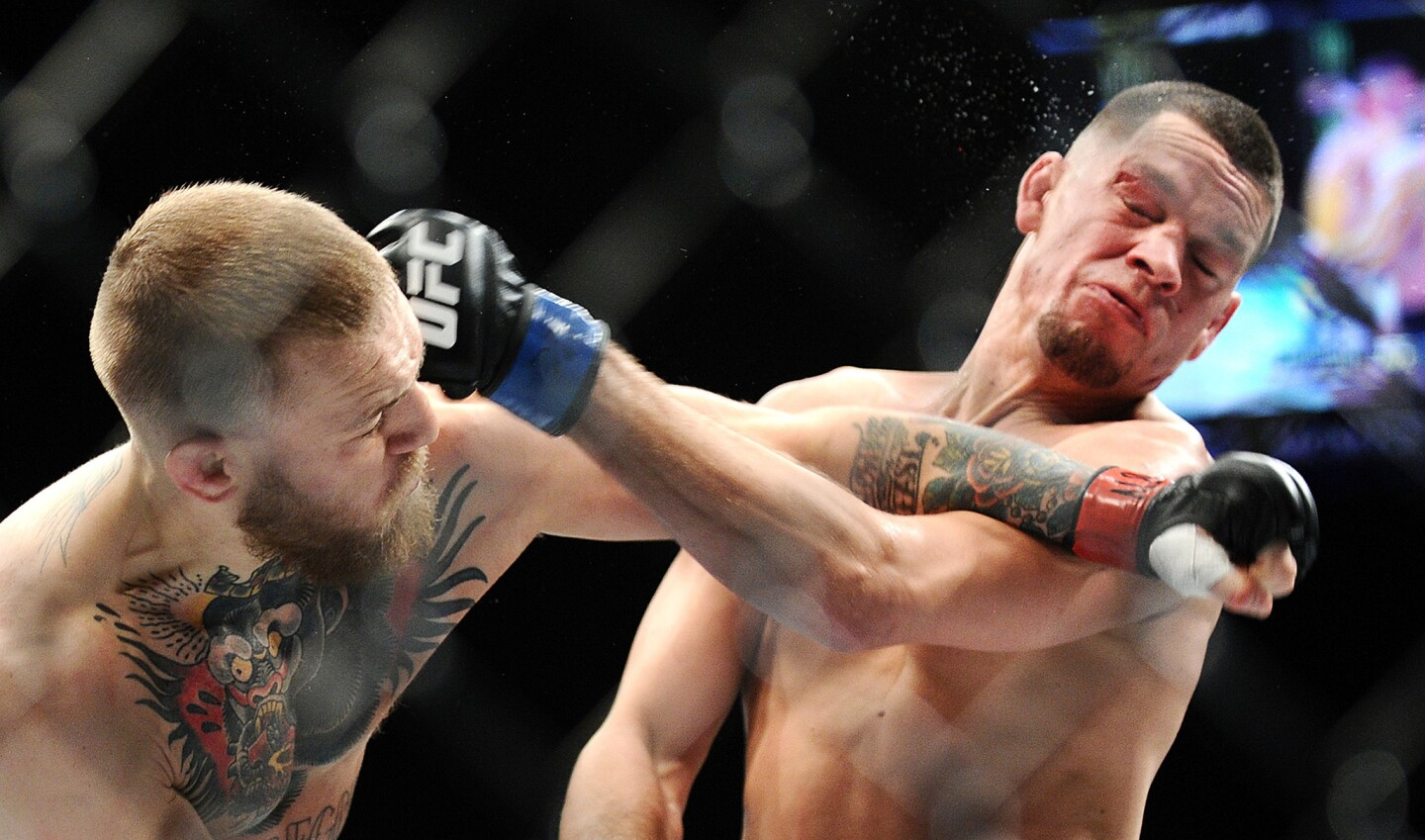 Conor McGregor, left, and Nate Diaz exchange punches during their welterweight fight at UFC 196 on March 5.