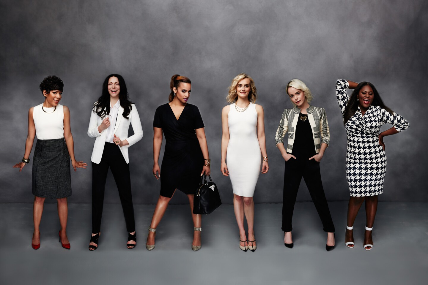 """Members of the """"Orange is the New Black"""" cast model some of the clothing being sold on Gilt.com to benefit Dress for Success. See some of the 300 items for sale in the following slides."""
