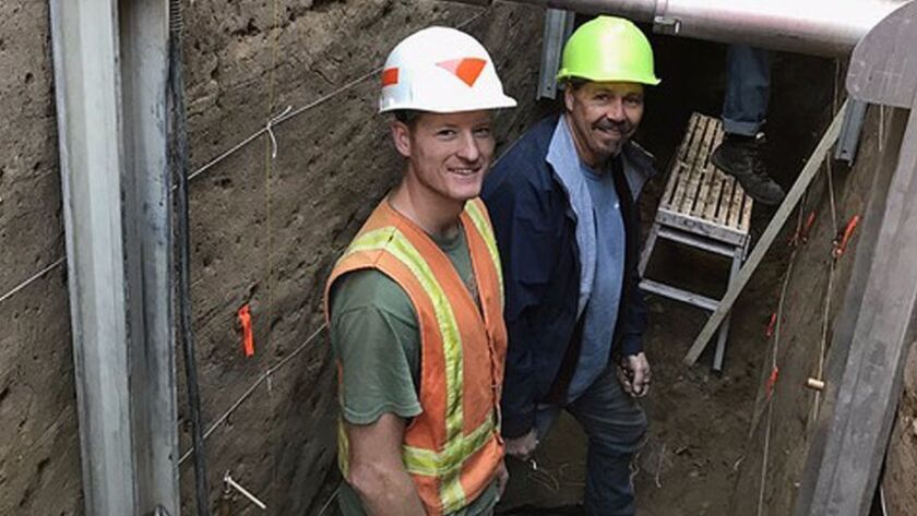 San Diego State University doctoral student Drake Singleton, and seismologist Tom Rockwell, stand in