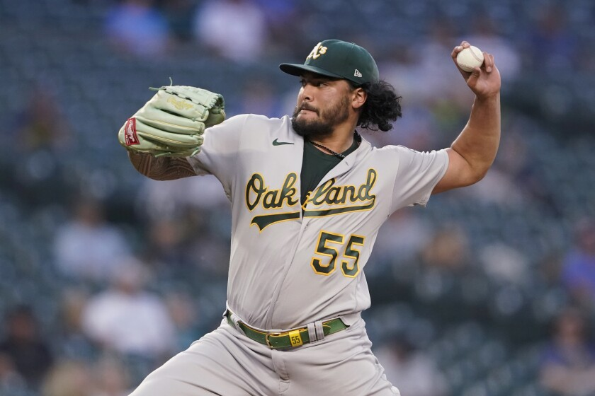 Oakland Athletics starting pitcher Sean Manaea throws to a Seattle Mariners batter during the fifth inning of a baseball game Wednesday, June 2, 2021, in Seattle. (AP Photo/Ted S. Warren)