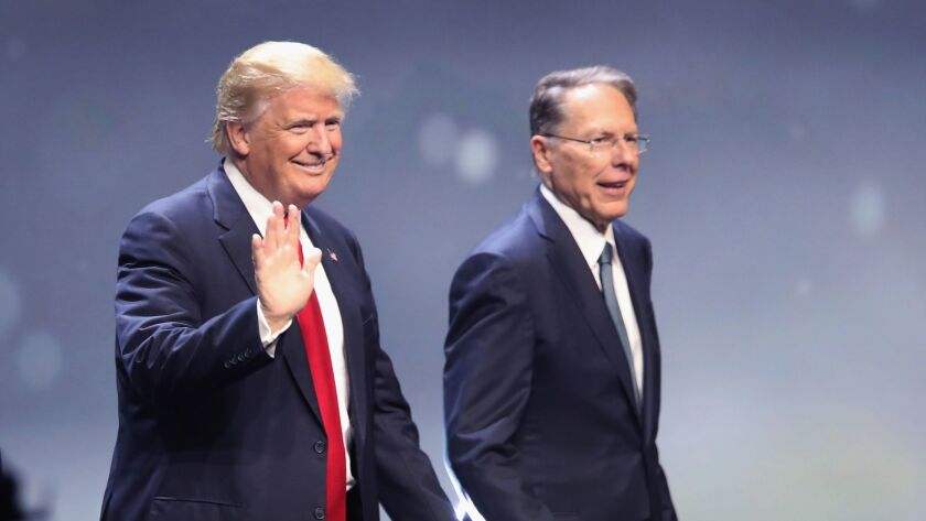 Donald Trump is introduced with Wayne LaPierre, Executive Vice President of the National Rifle Association, at the NRA's annual convention in Louisville, Kentucky on May 20.