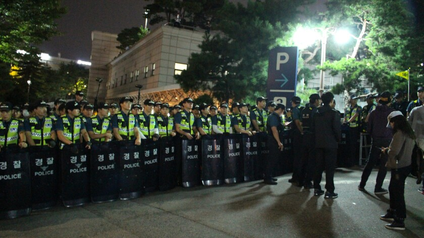 South Korean riot police block off an entrance to Seoul National University Hospital funeral home during a service for deceased farmer and activist Baek Nam-gi on Sep. 25, 2016.