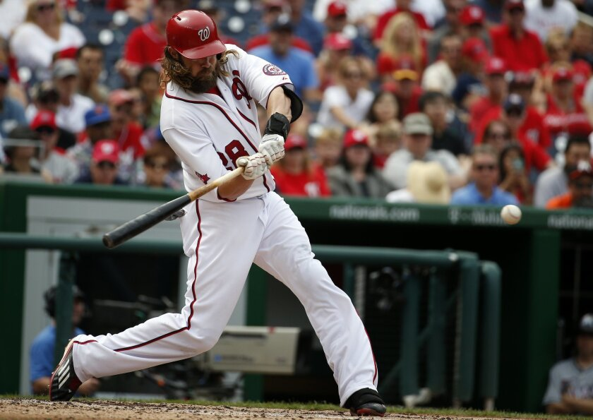 Washington Nationals' Jayson Werth hits a two-run home run during the third inning of a baseball game against the Miami Marlins at Nationals Park, Sunday, Aug. 30, 2015, in Washington. (AP Photo/Alex Brandon)