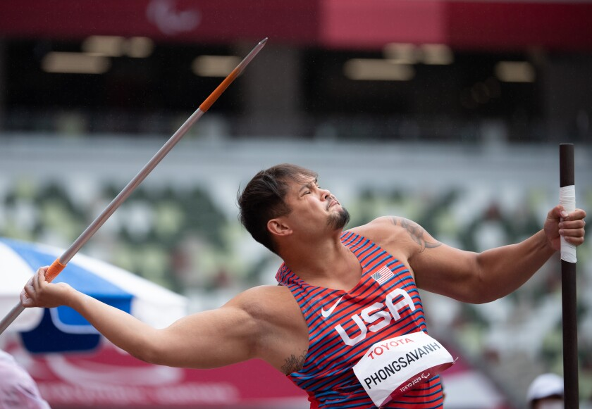 Justin Phongsavanh throws the javelin at the Paralympic Games in Tokyo on Sept. 3.
