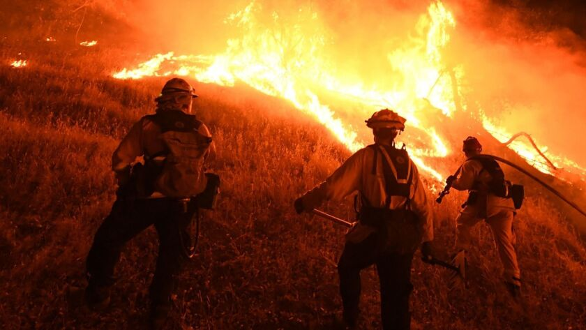 Verizon Wireless said it will stop imposing data speed restrictions on first responders on the West Coast after firefighters complained their data was being throttled by the company. In this file photo, firefighters conduct a controlled burn to defend houses from the Ranch fire.