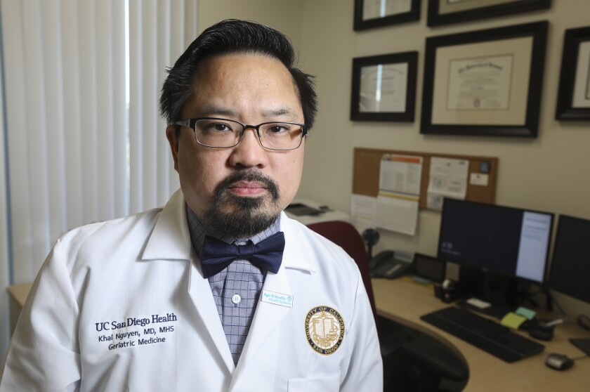 Dr. Khai Nguyen, a geriatrics/gerontology physician and associate professor at UC San Diego, poses for photos at his office near the Jacobs Medical Center UC San Diego Health building on April 2, 2020 in San Diego, California.