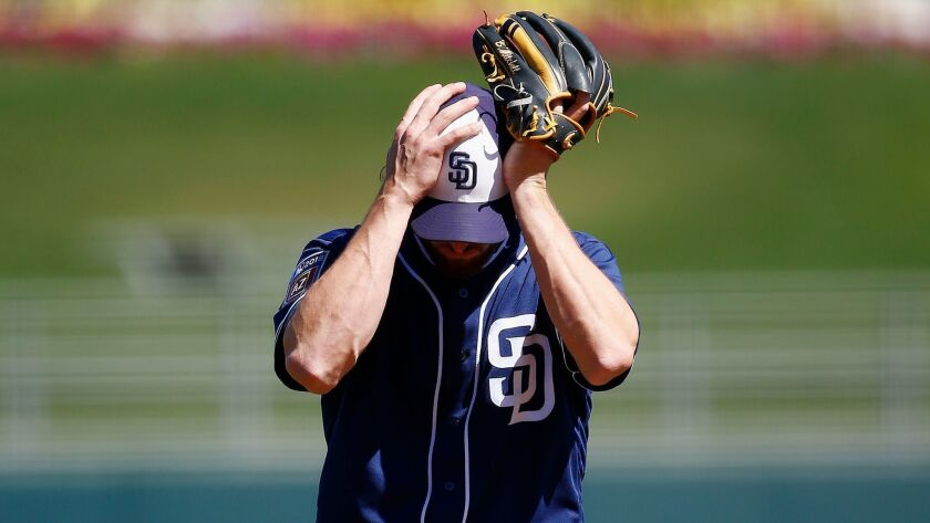 San Diego Padres starting pitcher Bryan Mitchell pauses on the mound after giving up a home run to K