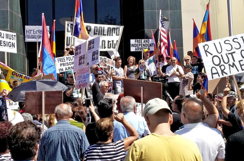 Nearly 1,000 people marched from Glendale City Hall to the Armenian embassy Sunday, rallying for the release of political prisoners in the Armenian capital of Yerevan.