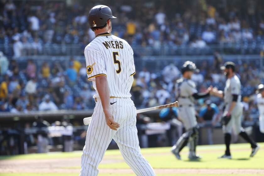 Padres' Wil Myers walks off after flying out to end a 7-0 loss to the Miami Marlins at Petco Park on Wednesday, August 11.