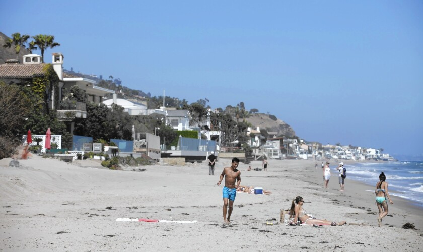 Beachgoers at Carbon Beach in Malibu, where a public pathway to the beach on the property of Lisette Ackerberg has been opened after a years-long dispute.