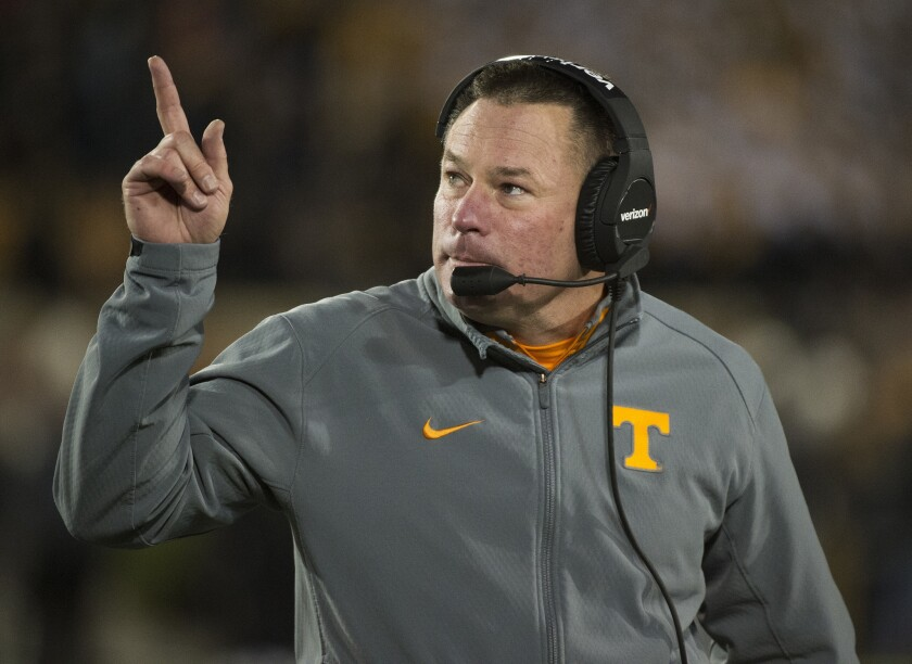 Tennessee Coach Butch Jones points to the scoreboard during a game against Missouri on Nov. 21.