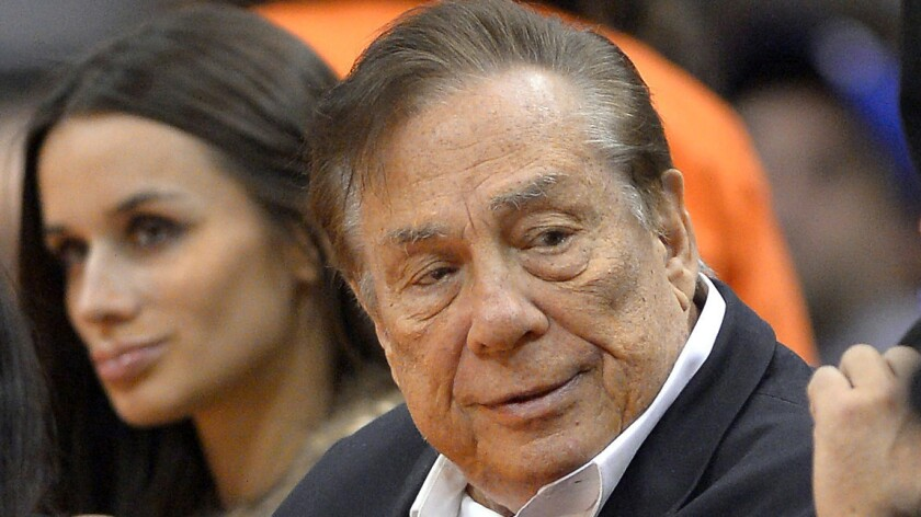 Clippers co-owner Donald Sterling looks on during a 2013 game between the Clippers and Sacramento Kings at Staples Center. A neurologist testified Monday that she concluded following an examination of Sterling that he suffered from Alzheimer's disease.