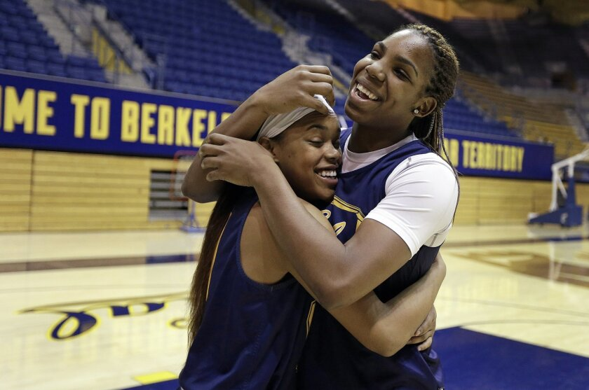 In this photo from Tuesday, Feb. 17, 2015, Brittany Boyd, left, and Reshanda Gray embrace before basketball practice at the University of California at Berkeley, Calif. These two seniors are a big reason the California Golden Bears have reached new levels under fourth-year coach basketball coach Lindsay Gottlieb, including reaching the program's first Final Four in 2013. Boyd, a playmaking point guard who grew up in Berkeley, is a projected top-five draft pick, while 6-foot-3 forward Gray is also high on many mock draft lists. (AP Photo/Ben Margot)