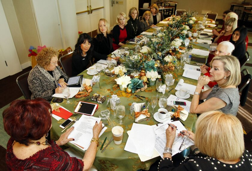 Members of the Dow Divas gather for their monthly meeting. The group will be donating $500,000 to the San Diego Opera.