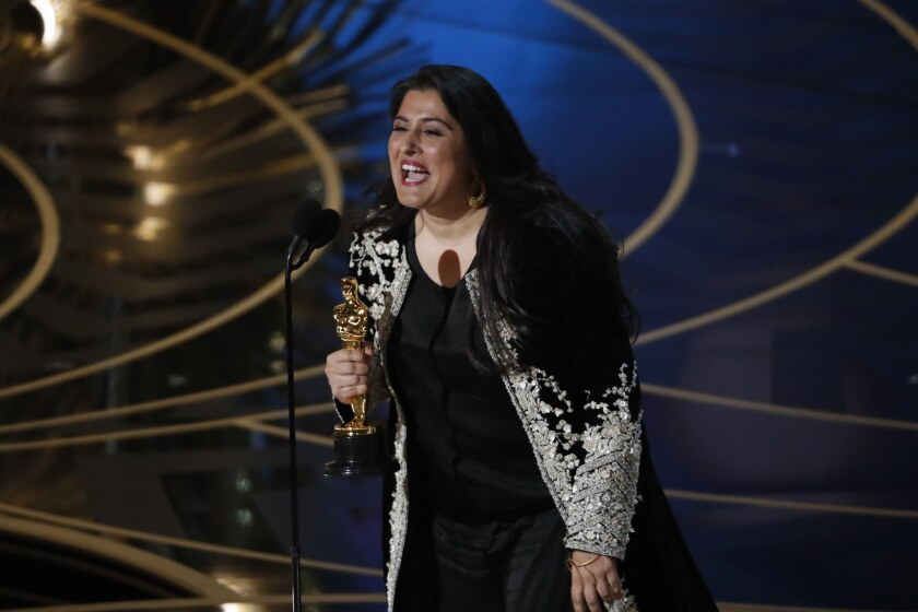 "Sharmeen Obaid-Chinoy with her Oscar for Best Short Documentary for ""A Girl in the River"" during the telecast of the 88th Academy Awards."