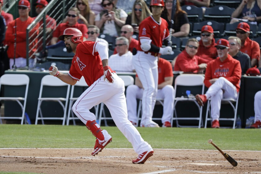 Los Angeles Angels' Anthony Rendon singles during the fourth inning of a spring training baseball game against the San Diego Padres, Thursday, Feb. 27, 2020, in Tempe, Ariz. (AP Photo/Darron Cummings)