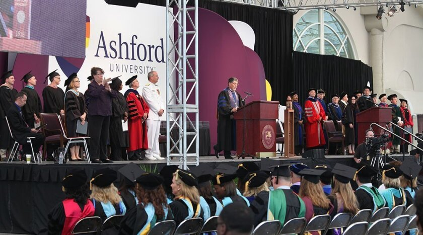 Dr. Richard Pattenaude, president of Ashford University, presided Sunday over the first commencement ceremony for the school being held in San Diego.