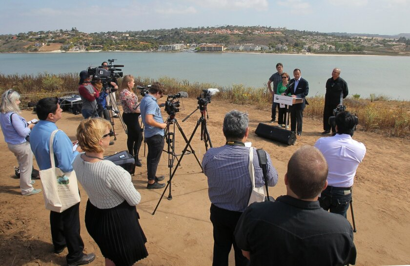 Developer Rick Caruso, CEO and founder of Caruso Affiliated, speaks at a press conference May 12 to announce a shopping center and preservation plans for the strawberry fields along Agua Hedionda Lagoon in Carlsbad.