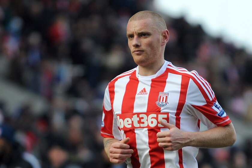 FILE- In this Jan. 26, 2013 file photo, Stoke City's Andy Wilkinson runs during their FA Cup fourth round soccer match against Manchester City at the Britannia Stadium in Stoke on Trent, England. Wilkinson has been forced into early retirement at the age of 31 due to a concussion he sustained while