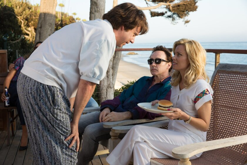 """This photo provided by Roadside Attractions shows, Paul Giamatti, from left, as Dr. Eugene Landy, John Cusack as Brian Wilson (older) and Elizabeth Banks as Melinda Ledbetter, in a scene from the film, """"Love & Mercy."""" (Francois Duhamel/Roadside Attractions via AP)"""
