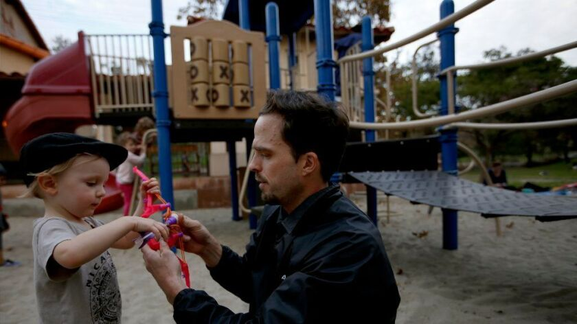 Primo Trunell, 2, plays with his father, Jeffrey Trunell, of Los Angeles, at a city playground in Silver Lake.