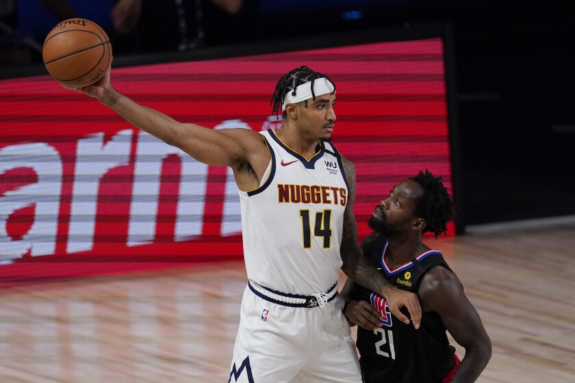 Denver Nuggets' Gary Harris keeps the ball from Clippers' Patrick Beverley.