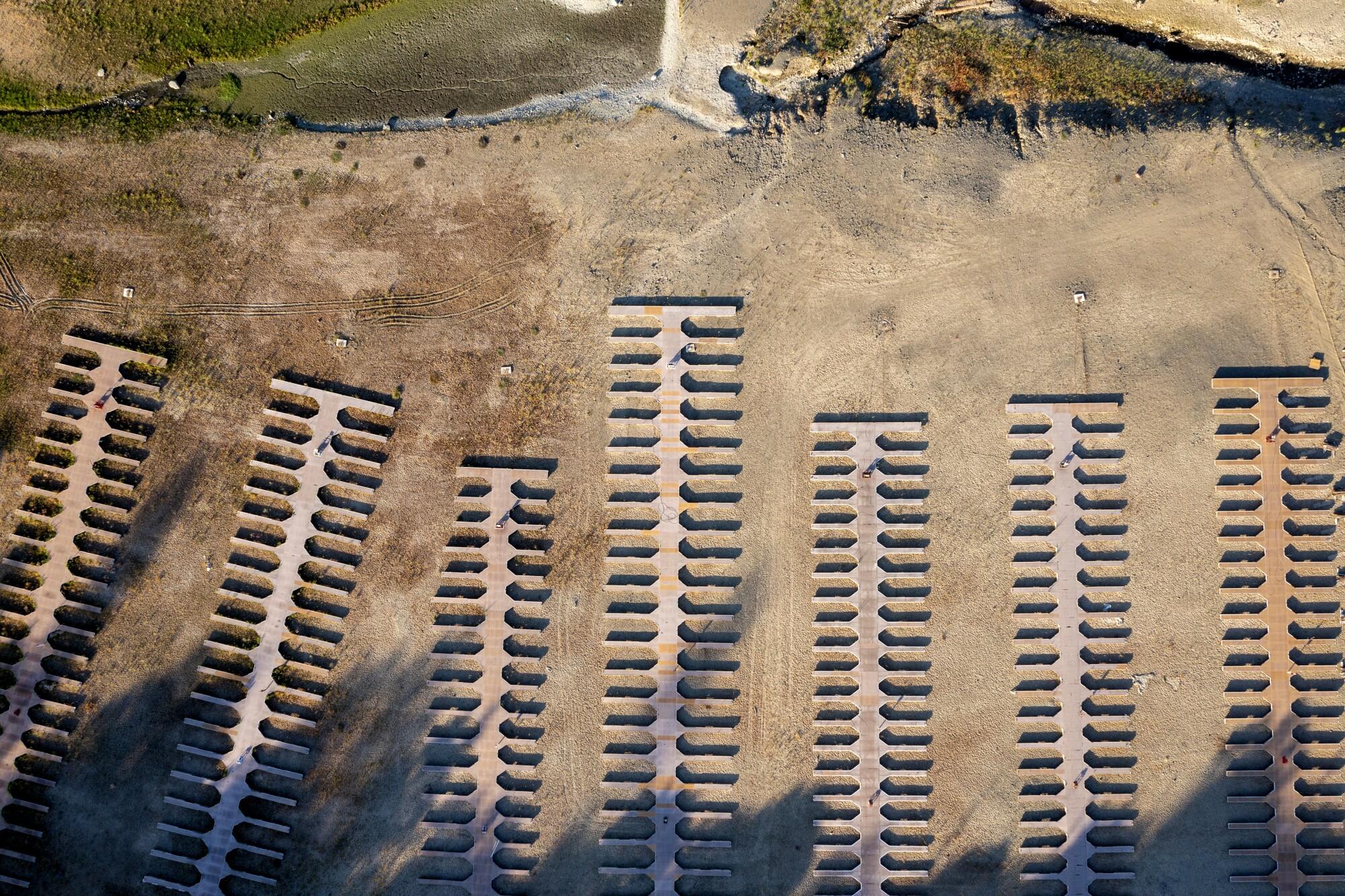 Boat slips lie stranded on dry land at drought-stricken Folsom Lake.